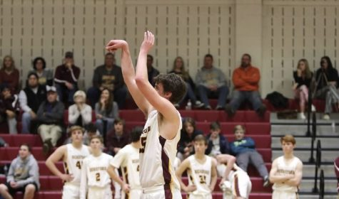 Suchy holds his follow through after shooting a free throw in overtime against Dundalk. The Bulls held on to win 59-56.