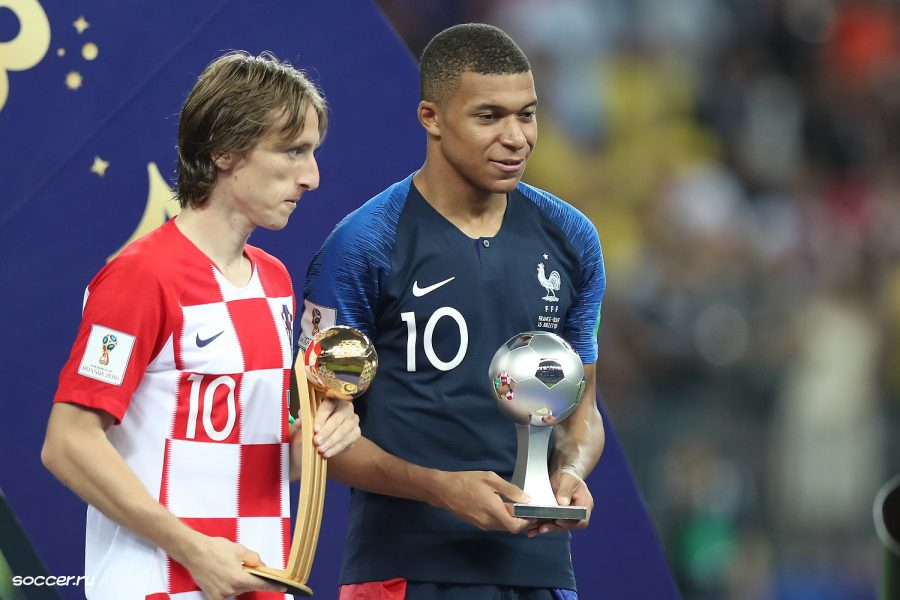 Luka Modric and Kylian Mbappe stand together after the World Cup Finals in Russia. The two participated in the hard-fought championship with France defeating Croatia 4-2; Modric won the player of the tournament and Mbappe won young player of the tournament.
