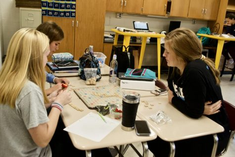 Courtney Craig ('22), Kayla Nieberlein ('22), and Piper Lentz ('22) play a game of Scrabble during one NEHS Monday in Mrs. Vance's room. Members were asked to invite other students to the event to play.