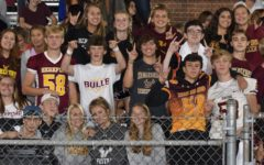 """Hereford fans show their pride with the """"bulls up"""" symbol. Hereford's students section cheered on the Bulls football team against Milford Mill."""