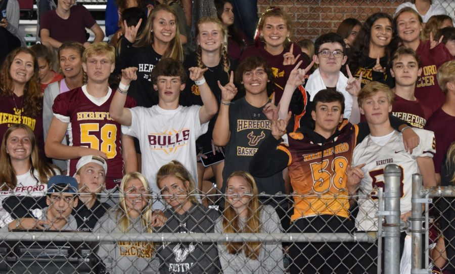 Hereford+fans+show+their+pride+with+the+%E2%80%9Cbulls+up%E2%80%9D+symbol.+Hereford%E2%80%99s+students+section+cheered+on+the+Bulls+football+team+against+Milford+Mill.