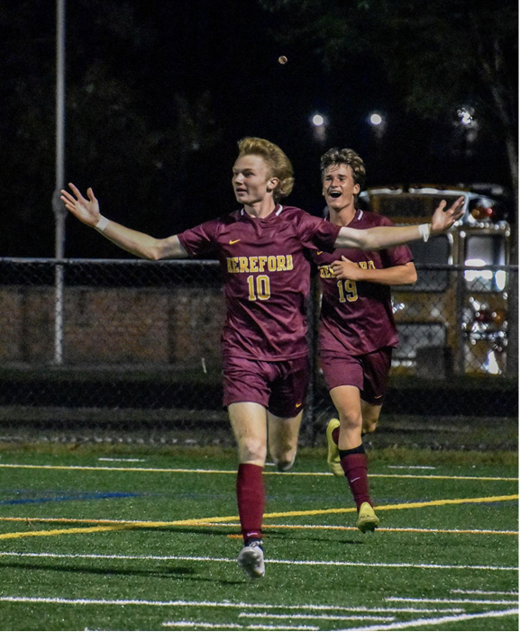 Logan Sinsebox (22) and Grayson Hammann (22) celebrate after a goal scored by Sinsebox in the second half.
