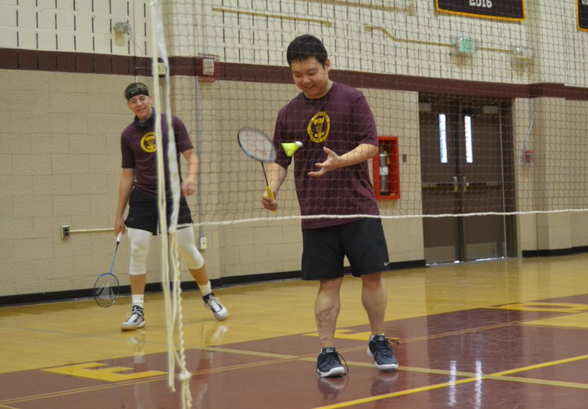Chung and Kinsey eye a gold medal at the Baltimore County Badminton Championships. The pair won their match against Franklin High School's top male doubles team with set scores of 15-2 and 15-1.