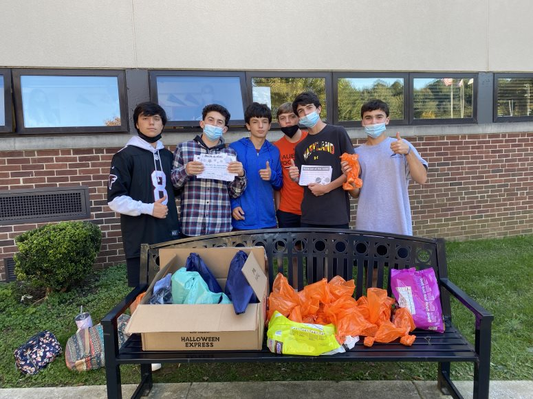 Evan Delibro ('24), Judd Steller ('24), Eddie Shamus ('24), Nick Westerburg ('24), Max Van Note ('24), and Jett Steller ('24) pose in front of several completed goodie bags. The group organized an assembly line style tactic for 45 minutes on Wednesday.