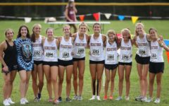 Members of the Lady Bulls' cross-country team pose for a race day photo. The team placed second in the Female Elite division.
